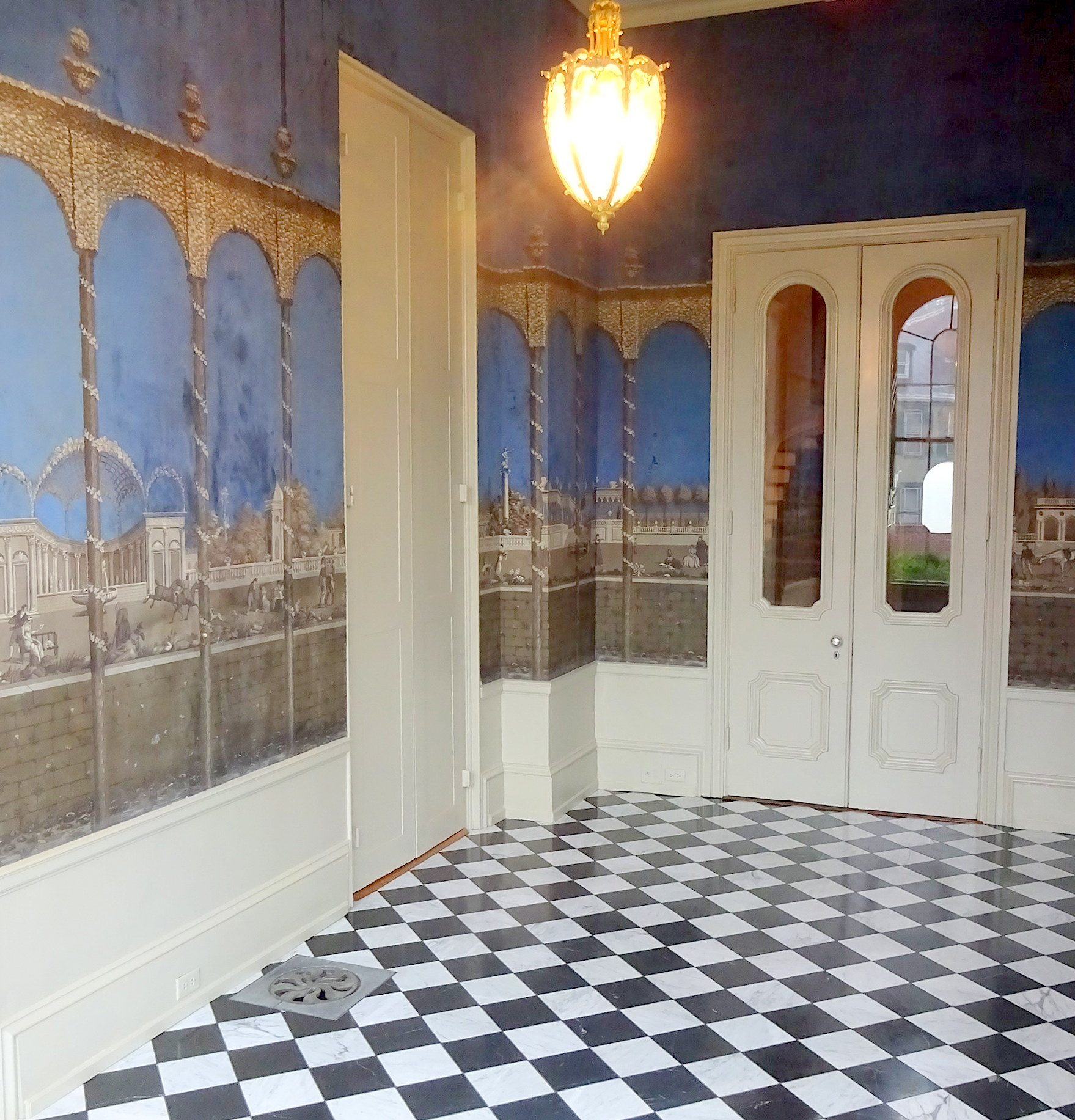 The Cameron Solariium with its unrestored19th century wallpaper.