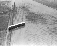 Flood waters bring a mobile home to rest in the middle of a farmer�s field.