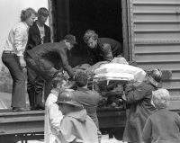 Penn Central Shuttle Service: Patient is carried from the boxcar.