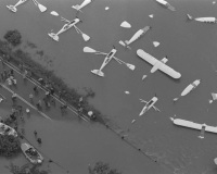 Planes at the Piper Aircraft Company in Lock Haven lie half-submerged by flood waters from the West Branch of Susquehanna River.