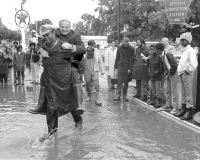 Governor Shapp is carried across flood waters by Constable Ed Watson.