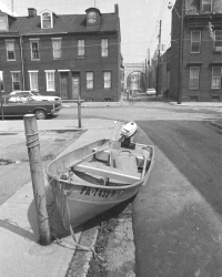 An abandoned boat is left tied to a post on South River Street (directly behind the current offices of the Historical Society of Dauphin County).