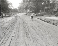After the waters recede, Front Street near the Harris-Cameron Mansion is left covered in mud.