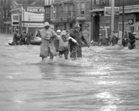 Rescue at Market and Cameron: Evacuees and rescue workers fight against the current from the Paxton Creek as it flows down Cameron Street.